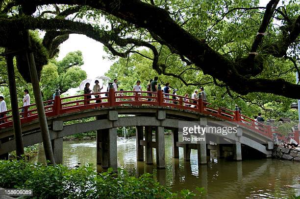 Pilgrims and tourists cross the bridge to Tenmangu Shrine in Dazaifu a shinto shrine built over the grave of a famous Japanese poet Michizane and one...