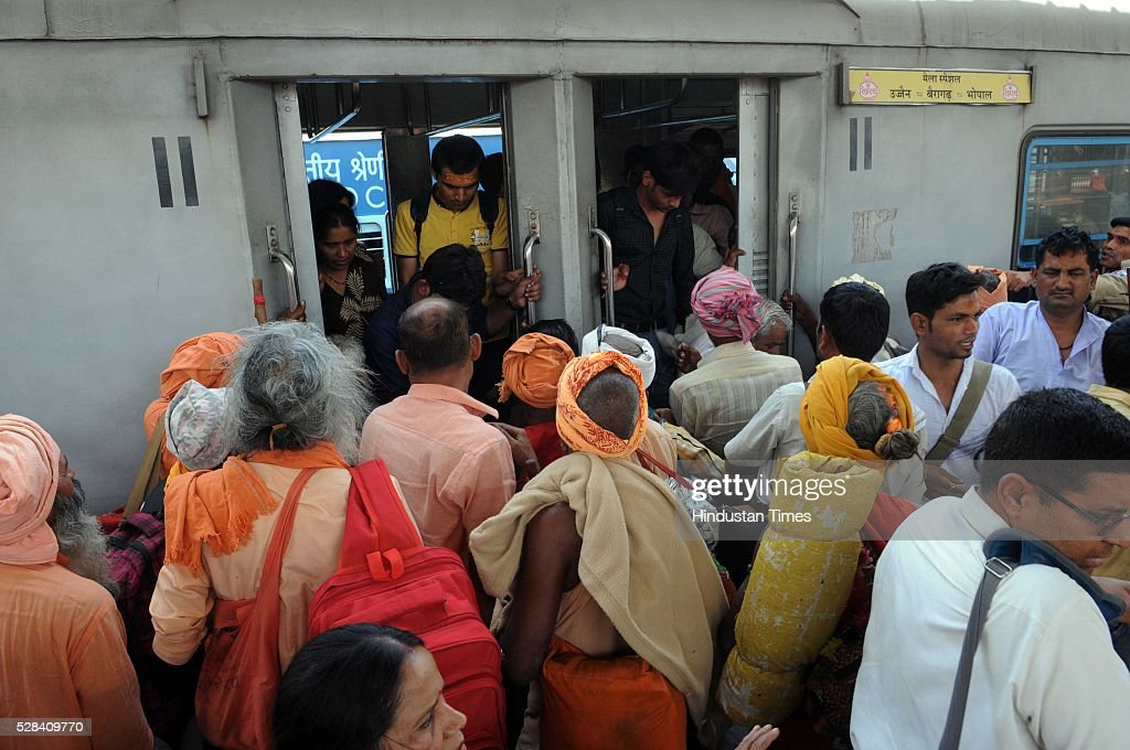 Pilgrims and visitors boarding a special train from Bhopal Railway Station for visiting Simhastha Kumbh Mela in Ujjain, Madhya Pradesh, on May 4, 2016 in Bhopal, India. The month-long Simhastha Kumbh Mela, largest congregation of Hindus began in Ujjain with the arrival of Juna Akhara for the royal bath on the banks of Kshipra river for the holy dip. A large number of people from different corners of the country have converged in the holy city for the Simhastha Mela, held every 12 years at Ujjain, which is also the abode of Lord Mahakaleshwar, one of the 12 Jyotirlings in the country.