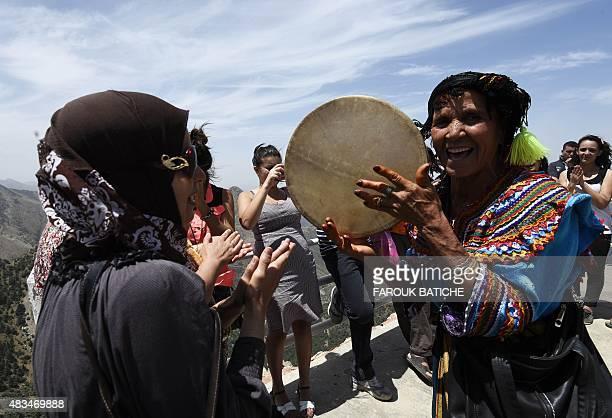 Pilgrims are seen in 'elJammaa Oufella' sitting above the Azro Nethor peak in the Djurdjura Mountain range884 meters above sea level in Algeria's...
