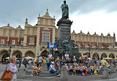Pilgrims at the Adam Mickiewicz monument in Krakow's main Square Thousands of pilgrims from around the world arrive to Krakow on the eve of the World...