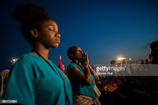 Pilgrims attend a vigil ceremony with Pope Francis in Campus Misericoradiae on July 30 2016 near Krakow Poland Almost two million young people are...