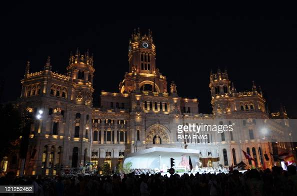 Pilgrims attend the inaugural mass of the World Youth Day at Cibeles square in Madrid on August 16 2011 Hundreds of thousands of sweltering pilgrims...