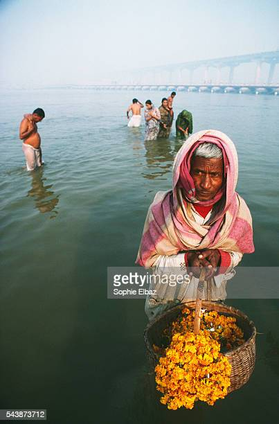 Pilgrims bathe in the holy river during the Kumbh Mela festival to purify them of their sins