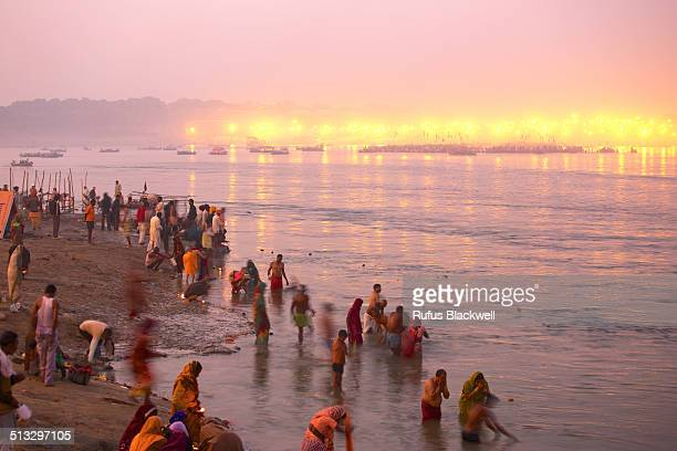 Pilgrims bathe on the banks of the Ganges
