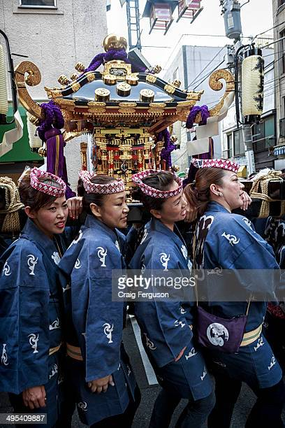 TEMPLE ASAKUSA TOKYO JAPAN Pilgrims carry a mikoshi or divine palanquin during a Japanese festival Sanja Matsur is an annual Shinto festival held in...