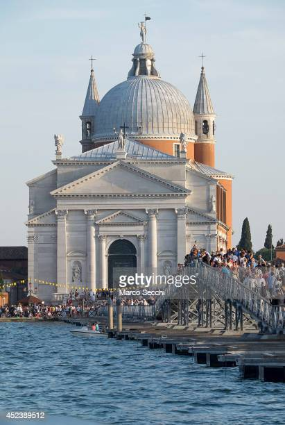 Pilgrims cross the votive bridge to the Redentore Church on July 19 2014 in Venice Italy Redentore which is in remembrance of the end of the 1577...