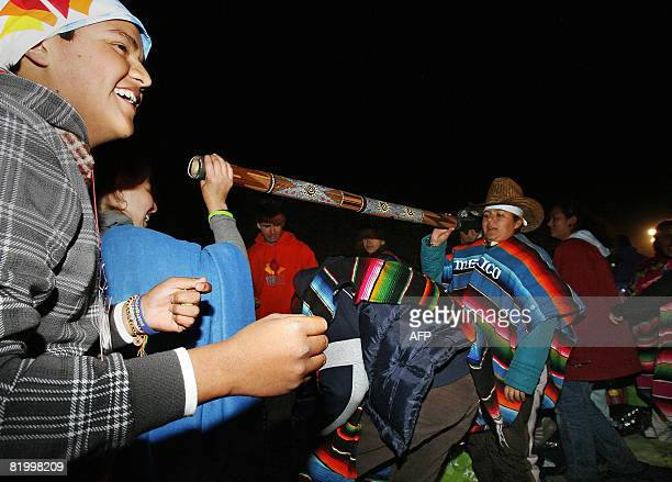 Pilgrims entertain themselves by playing limbo prior to a World Youth Day prayer ceremony with Pope Benedict XVI in Sydney on July 19 2008 The World...