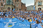 Pilgrims from Argentina outside the Mariacki Basilica in Krakow's main Square Thousands of pilgrims from around the world arrive to Krakow on the eve...