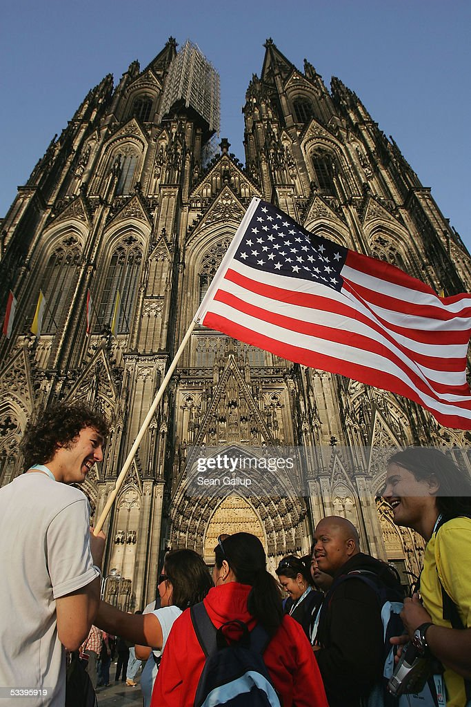 Pilgrims from Kansas in the United States gather with other pilgrims in front of the Koelner Dom Cathedral August 16, 2005 in Cologne, Germany. Hundreds of thousands of Catholic pilgrims have descended on the city for World Youth Day and the visit of Pope Benedict XVI, who is scheduled to arrive Thursday for a four-day visit.