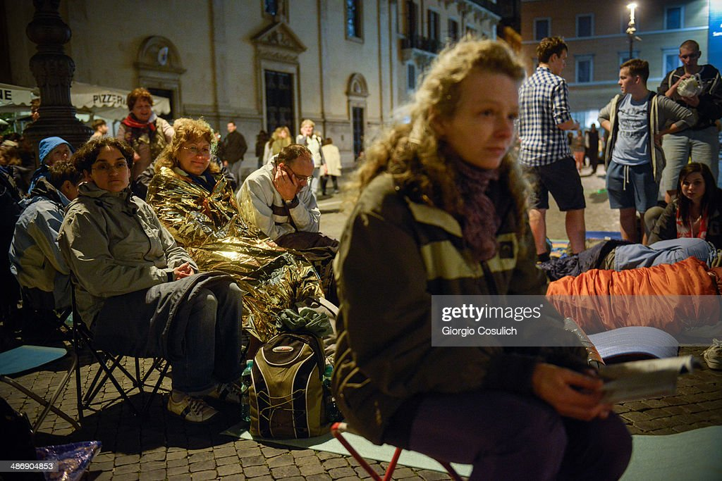 Pilgrims from Poland get ready to spend the night after a Mass celebration in front of the Church of Santa Agense in Agona, at Piazza Navona on April 26, 2014 in Rome, Italy. Dignitaries, heads of state and Royals from Europe and across the World are gathering in the Vatican ahead of tomorrow's canonisations. The late Pope John Paul II and Pope John XXIII will be canonised on Sunday April 27, inside the Vatican when 800,000 pilgrims from around the world are expected to attend.