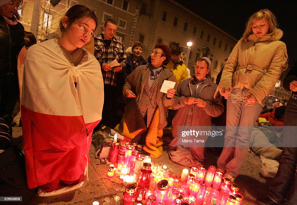 Pilgrims from Poland pray outside Saint Peter's Square just before midnight waiting for the funeral of Pope John Paul II April 7 2005 in Rome Italy...