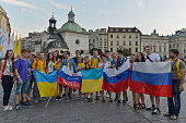 Pilgrims from Russia pose for a picture with a group of pilgrims from Ukraine in Krakow's main Square Thousands of pilgrims from around the world...