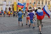 Pilgrims from Russia walk toward a group of pilgrims from Ukraine in Krakow's main Square Thousands of pilgrims from around the world arrive to...