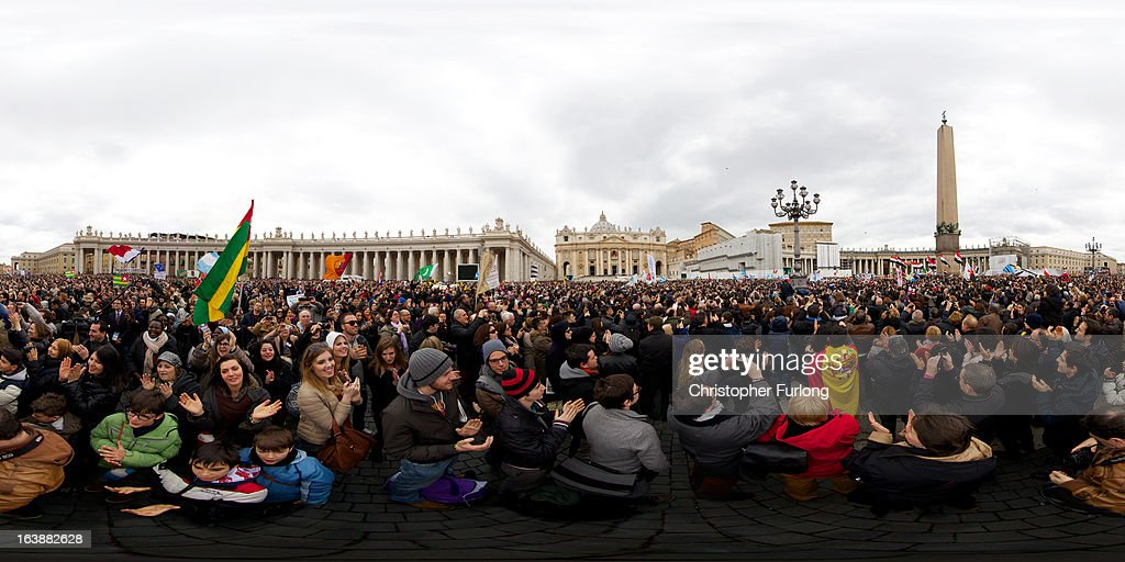 Pilgrims gather as Pope Francis gives his first Angelus Blessing to the faithful from the window of his private residence in St Peter's Square on March 17, 2013 in Vatican City, Vatican. The Vatican is preparing for the inauguration of Pope Francis on March 19, 2013 in St Peter's Square.