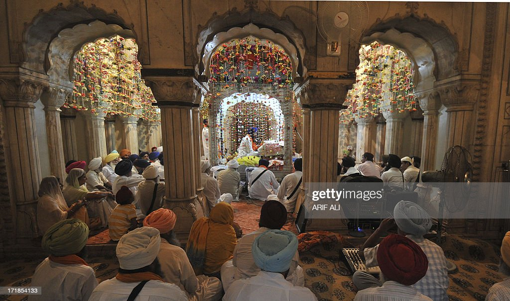 Pilgrims gather at a Sikh shrine in Lahore on June 29, 2013, on the 174th death anniversary of Maharaja Ranjit Singh. Singh was also known as 'Sher-e-Punjab' or 'Lion of Punjab' and is remembered for uniting the Punjab as a strong nation and his possession of the Koh-i-noor diamond. Singh, who was born in Gujranwala in 1780, was the ruler of the Pakistani Punjab province and died on June 27, 1839. AFP PHOTO/Arif ALI