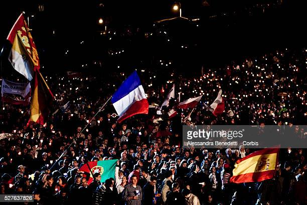 Pilgrims hold candles at the ancient Circus Maximus arena during a prayer vigil on the eve of the beatification of late Pope John Paul II on April 30...