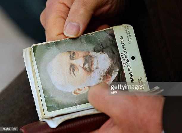 A pilgrims holds an mass kooklet before an open mass to mark the anniversary of Padre Pio's death and the display of his body for public viewing at...