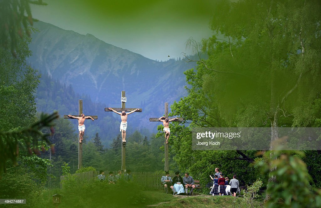 Pilgrims in traditional Bavarian folk costumes stand beneath three crosses on the Kalvarienberg-mountain and follow an outdoor mass to celebrate Ascension (in German called Christi Himmelfahrt) at the open-air altar at Birkenstein on May 29, 2014 near Fischbachau, Germany. Approximately 2,000 pilgrims from 40 different folk group associations participated in the annual event to mark Jesus Christ's ascension to Heaven. Bavaria is predominantly Catholic.