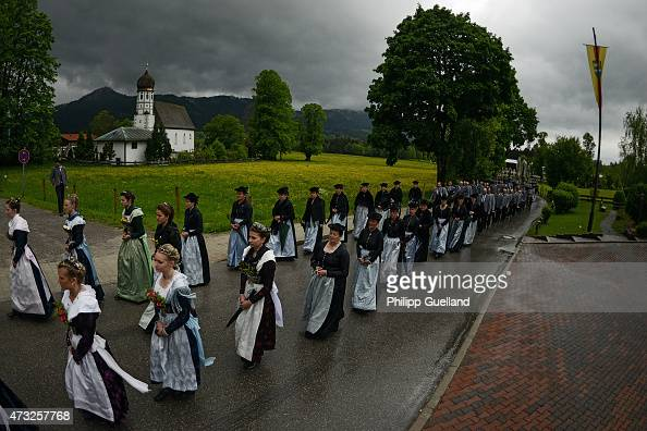 Pilgrims in traditional Bavarian folk dress walk to attend the annual Ascension Mass at the openair altar at Birkenstein on May 14 2015 near...