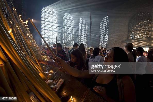 Pilgrims light candles at a chapel during the feast of Our Lady Aparecida at the Basilica of Aparecida in Aparecida 180 km east of Sao Paulo Brazil...