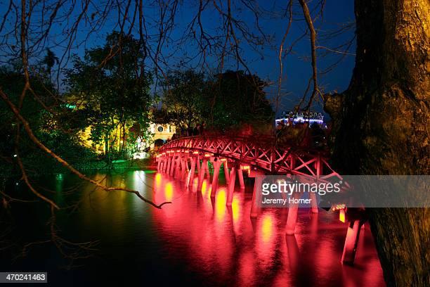 Pilgrims make their way during 'Tet' to Den Ngoc Son Temple of the Jade Mountain on an island in Hoan Kiem Lake in Hanoi