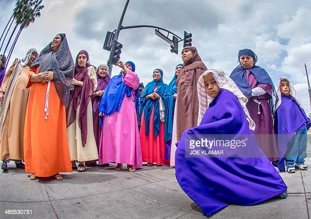 Pilgrims participate in the Good Friday procession near La Placita Church in downtown Los Angeles California on April 18 2014 Good Friday...
