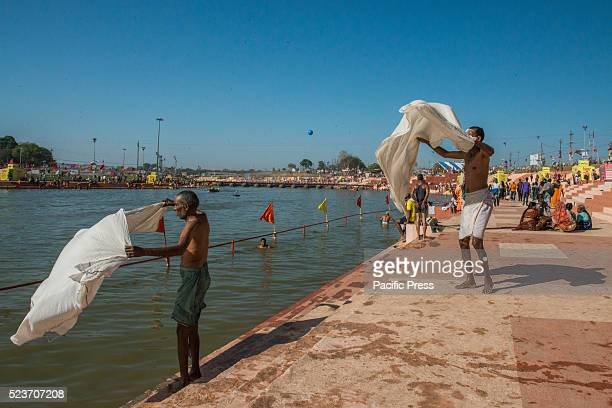 Pilgrims participate in the monthlong great bathing festival or Simhastha Mela [Kumbh Mela] in Ujjain Thousands of pilgrims gathered in this holy...