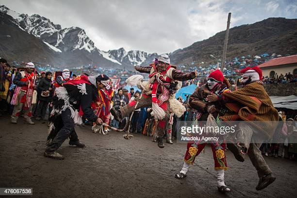 Pilgrims participate in the Qoyllur Rit'i religious festival more than 1000 kms southeast from Lima Peru on June 1 2015 Quyllur Rit'i or Star Snow...