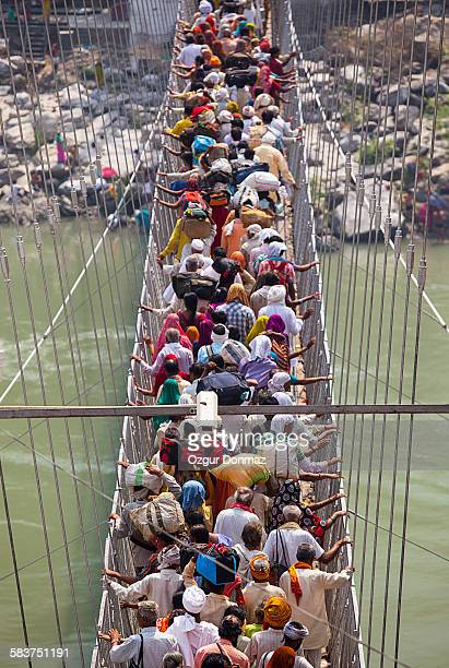 Pilgrims passing the Laksman Jhula Bridge, India
