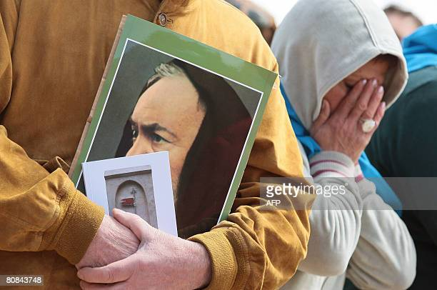 Pilgrims pray during an open mass to mark the anniversary of Padre Pio's death and the display of his body for public viewing at San Giovanni Rotondo...
