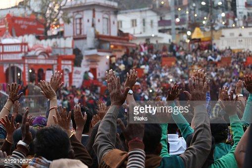 Pilgrims praying during Ganga Aarti at Har Ki Pauri