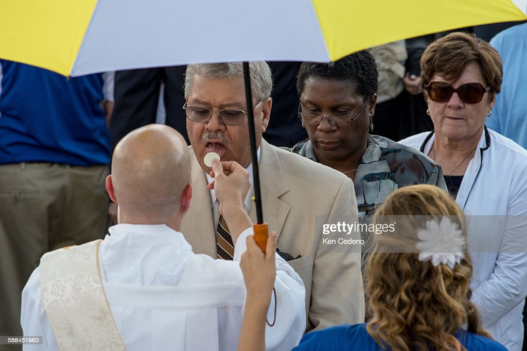 Pilgrims recieve communion during services as Pope Francis conducts mass and the Canonization of Blessed Junipero Serra at the Basilica of the...