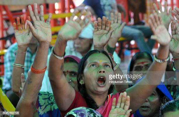 Pilgrims shouting religious slogans at yatri base camp on July 4 2017 in Jammu India Another batch of 1786 pilgrims on Tuesday left Jammu for the...