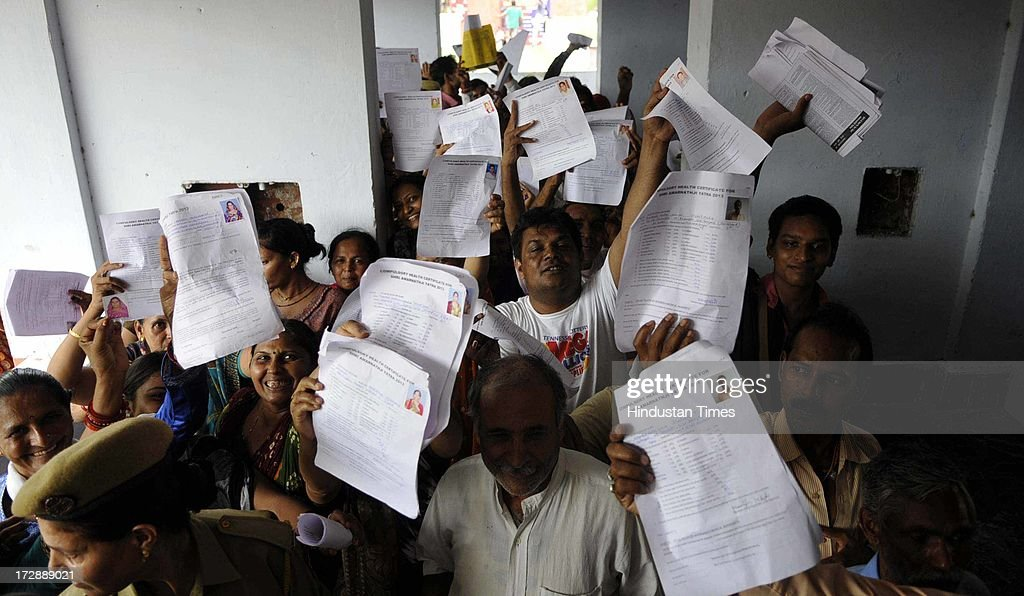 Pilgrims showing application forms as they standing in a queue for the registration for the annual pilgrimage to the Amarnath cave shrine at registration centre on July 5, 2013 in Jammu, India. Jammu and Kashmir Government said it will not allow any unregistered pilgrim to Amarnath cave shrine. Thousands of pilgrims annually visit the remote Himalayan shrine of Amarnath at 3,888 meters (12,756 feet) above sea level to worship an icy stalagmite representing Shiva, the Hindu god of destruction.