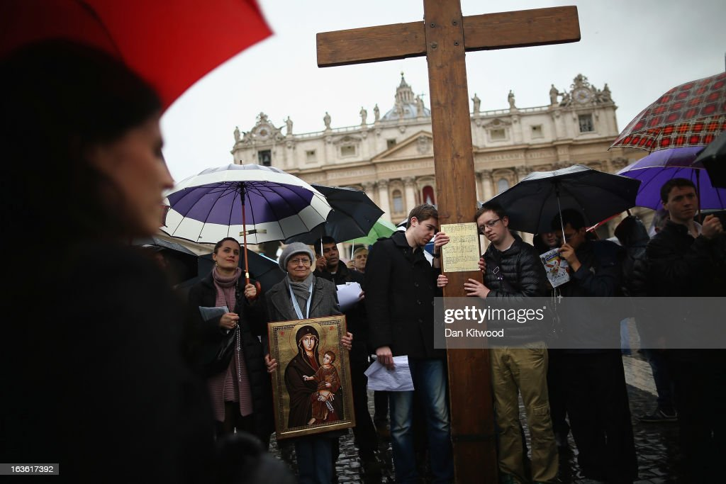 Pilgrims sing around a cross in St Peter's Square on March 13, 2013 in Vatican City, Vatican. Argentinian Cardinal Jorge Mario Bergoglio was later elected as the 266th Pontiff and will lead the world's 1.2 billion Catholics.