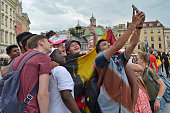 Pilgrims take a selfie in Krakow's main Square Thousands of pilgrims from around the world arrive to Krakow on the eve of the World Youth Day 2016 On...