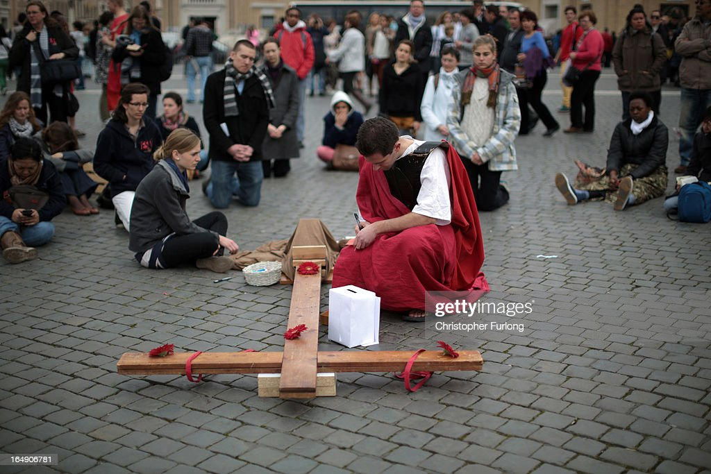 Pilgrims take part in a stations of the cross ceremony in St Peter's Square on March 29, 2013 in Vatican City, Vatican.