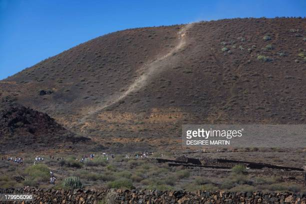 Pilgrims take part in the annual pilgrimage of the Virgin del Socorro on the Spanish Canary island of Tenerife on September 7 2013 The pilgrimage of...