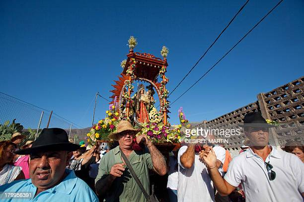 Pilgrims take part in the annual procession of the Virgin del Socorro on the Spanish Canary island of Tenerife on September 7 2013 The pilgrimage of...