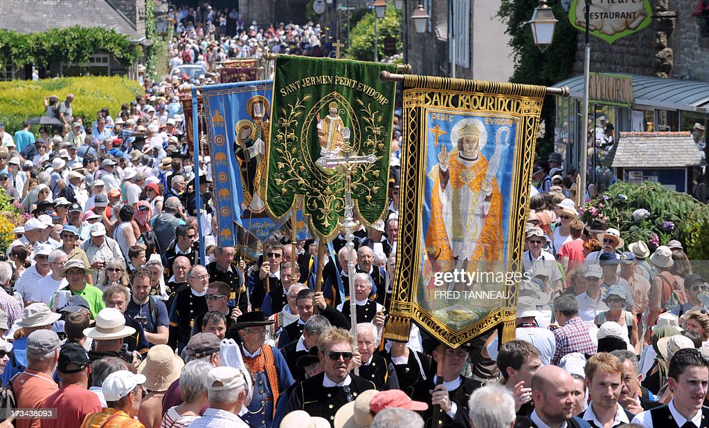 Pilgrims take part in the 'Grande Tromenie', on July 14, 2013 in Locronan in Brittany, western France, one of the oldest Breton 'pardons', a procession which gathers thousands of Catholic pilgrims. The religious event old of at least 500 years takes place every six years, gathering thousands of pilgrims who walk and pray, following 5th and 6th century Irish evangelist monk Saint-Ronan's footsteps.