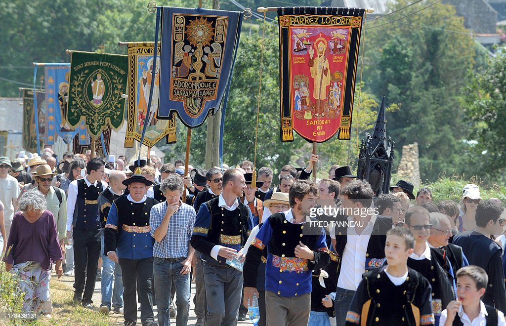 Pilgrims take part in the 'Grande Tromenie', on July 14, 2013 in Locronan in Brittany, western France, one of the oldest Breton 'pardons', a procession which gathers thousands of Catholic pilgrims. The religious event old of at least 500 years takes place every six years, gathering thousands of pilgrims who walk and pray, following 5th and 6th century Irish evangelist monk Saint-Ronan's footsteps. AFP PHOTO / FRED TANNEAU