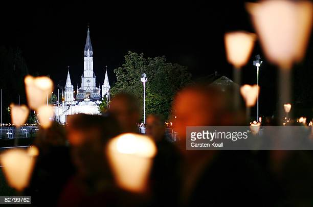 Pilgrims take part on a candlelight procession on September 12 2008 in Lourdes France Pope Benedict XVI is on his first apostolic visit in France and...