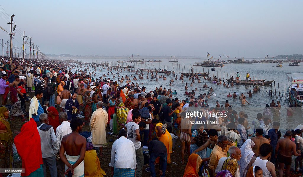 Pilgrims taking holy dip in Sangam waters on Mahashivratri Snan, in a Kumbh Mela area, on March 10, 2013 in Allahabad, India. The snan marked conclusion of the 55-day Mahakumbh during which around 8 crore pilgrims took the holy dip in the Sangam waters.