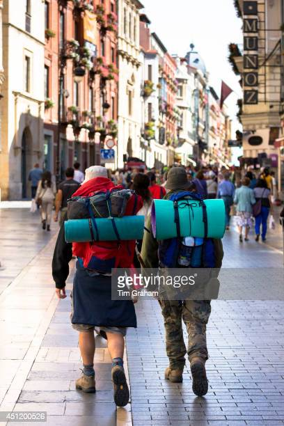 Pilgrims travelling on Camino Santiago reach Calle Ancha in Leon Castilla y Leon Spain