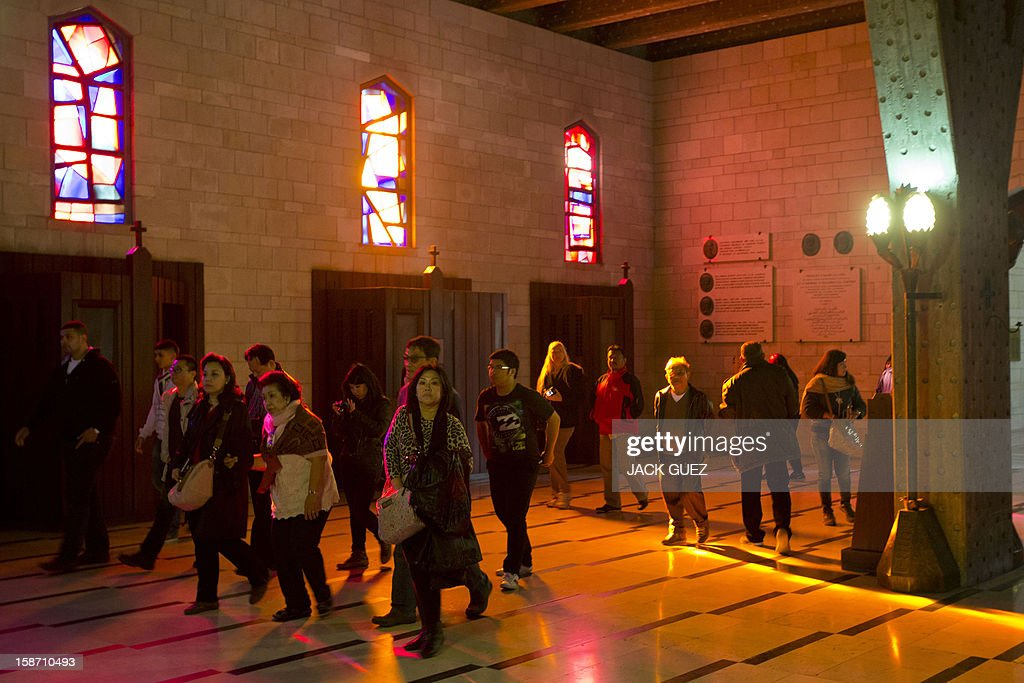 Pilgrims visit the Nazareth's Basilica of the Annunciation built on the site where Christians believe Virgin Mary was told by the angel Gabriel that she would give birth to Jesus Christ, in the northern Arab-Israeli city of Nazareth on December 25, 2012.