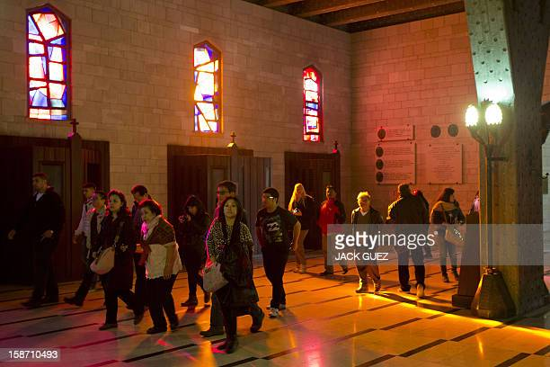 Pilgrims visit the Nazareth's Basilica of the Annunciation built on the site where Christians believe Virgin Mary was told by the angel Gabriel that...