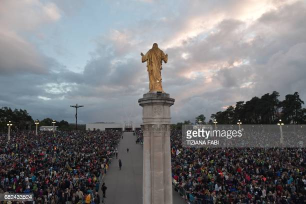 Pilgrims wait for Pope Francis at the Shrine of Fatima before the Blessing for the Candles from the Chapel of the Apparitions in Fatima on May 12...