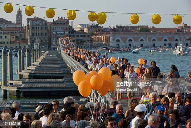 Pilgrims walk on the votive bridge for the Redentore Celebrations on July 20 2013 in Venice Italy Redentore is one of the most loved celebrations by...
