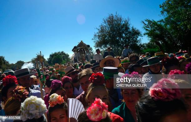 Pilgrims walk to cross the Ajoli bridge as the Rocio virgin is carried in a carriage in the village of Rocio during the annual El Rocio pilgrimage on...