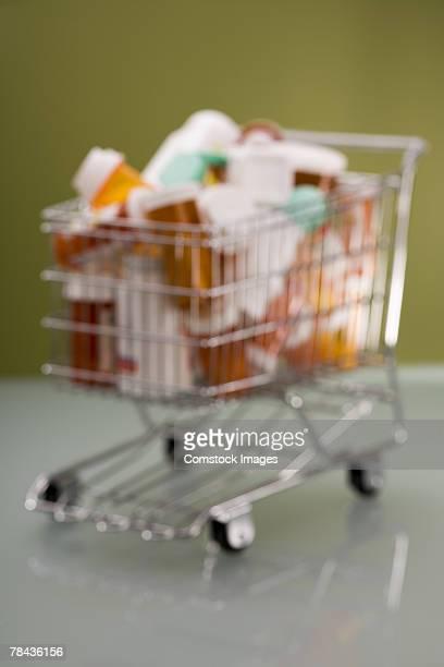 Pill bottles in shopping cart